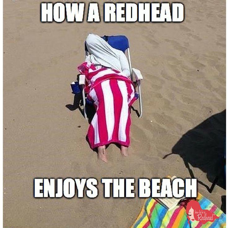 redhead enjoying the beach